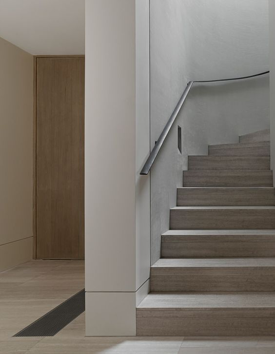 Modern staircase with flush recessed molding and reveal shadow trim.jpg