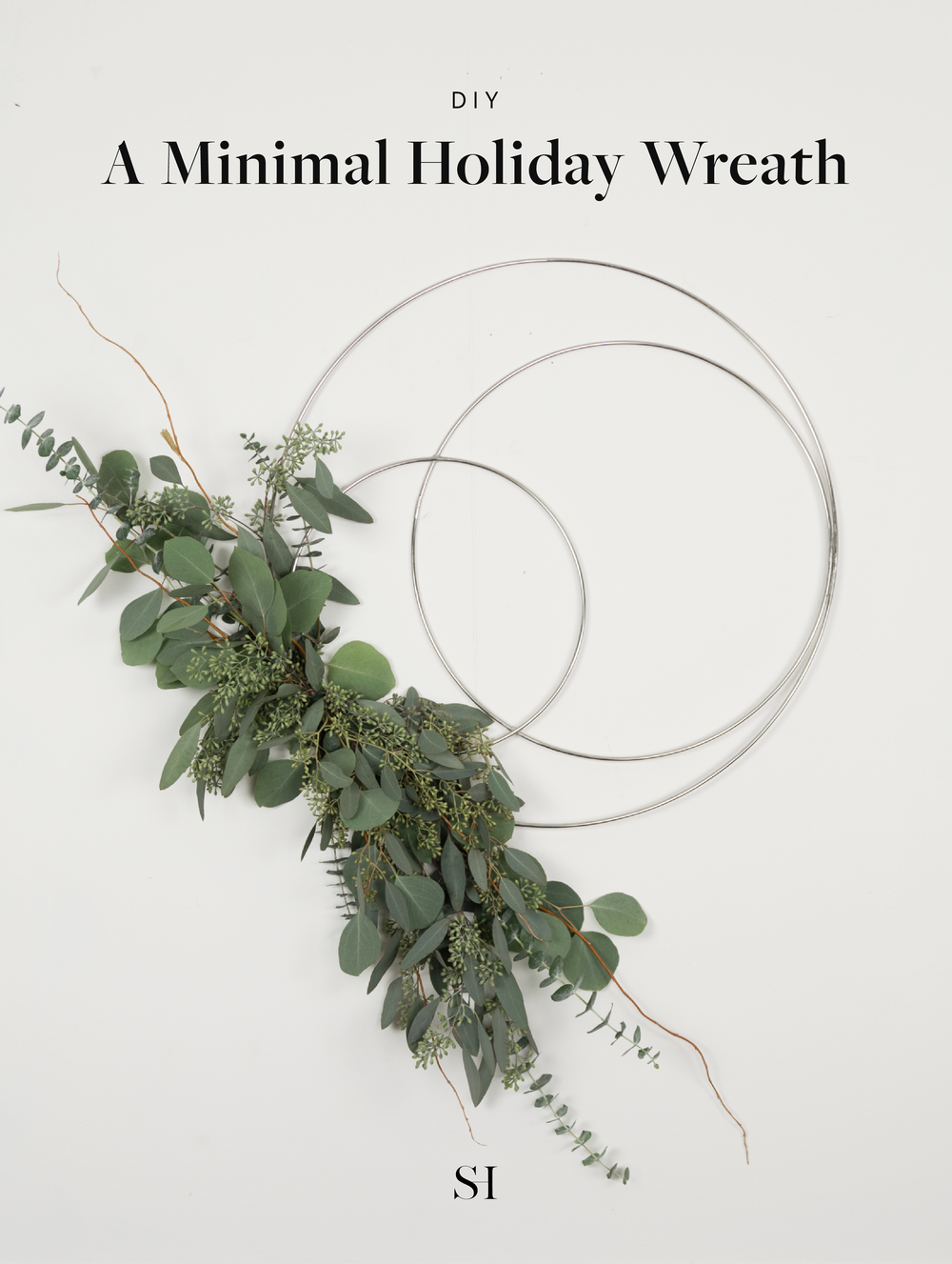 Asymmetrical Minimal and Modern Holiday Wreath with Fresh Eucalyptus and Silver Metal Hoops