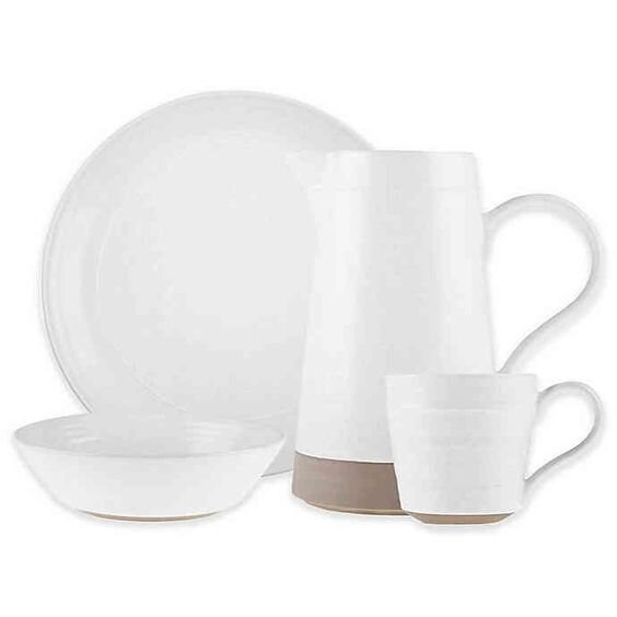 Rustic white dinnerware with black specs for a minimal and simple holiday table setting.jpg