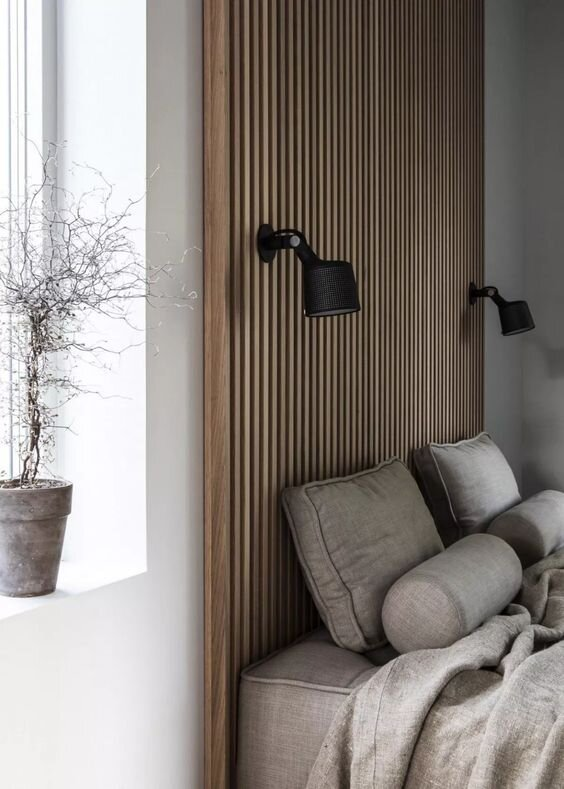 wood slatted accent wall above natural and modern bed - Winter 2019 2020 interior design trends.jpg