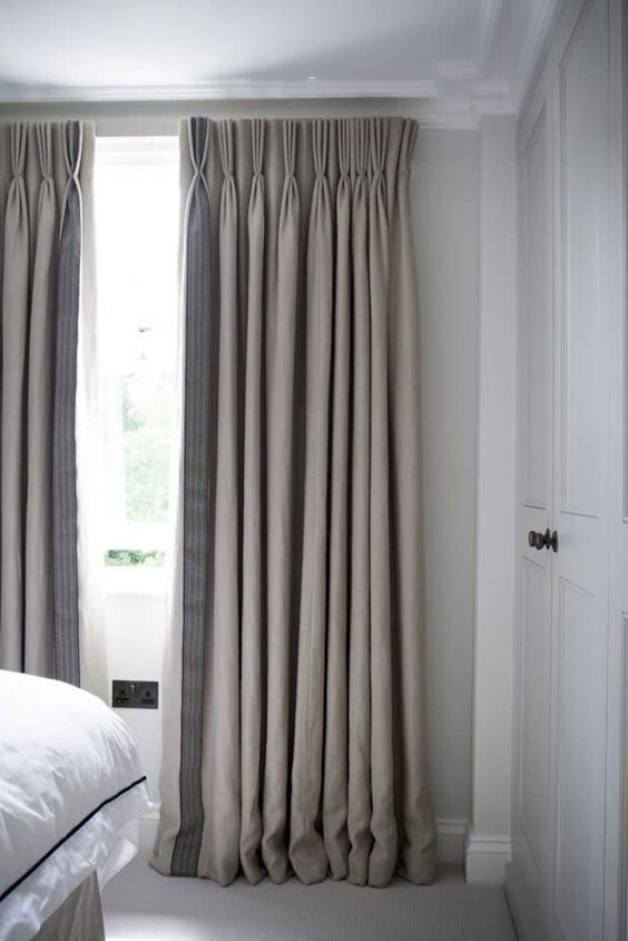 Beige pinch pleat curtains - the six types of drapery types and styles by the savvy heart interior design studio and DIY blog.jpg