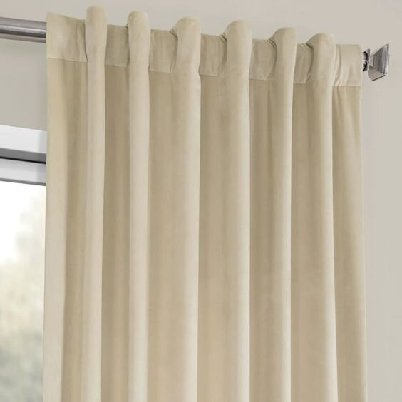 beige plush velvet curtain drapes - pros and cons of different drapery styles by the savvy heart interior design studio.jpg