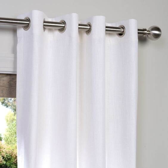 heavy linen curtains for a modern contemporary living room - pros and cons of different drapery styles.jpg