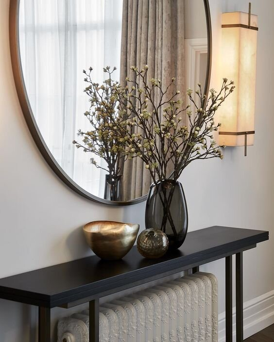 Minimal black and brass console table over radiator - What's the difference between console, sofa, and end tables and does it matter - by the savvy heart.jpg