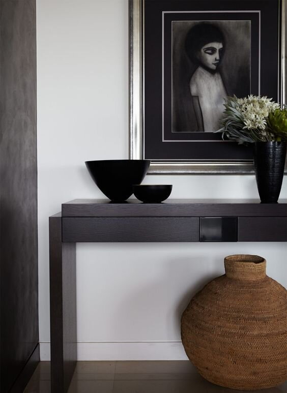 Modern and contemporary entryway with black console table and white walls - the difference between console, sofa, and end tables and does it matte.jpg