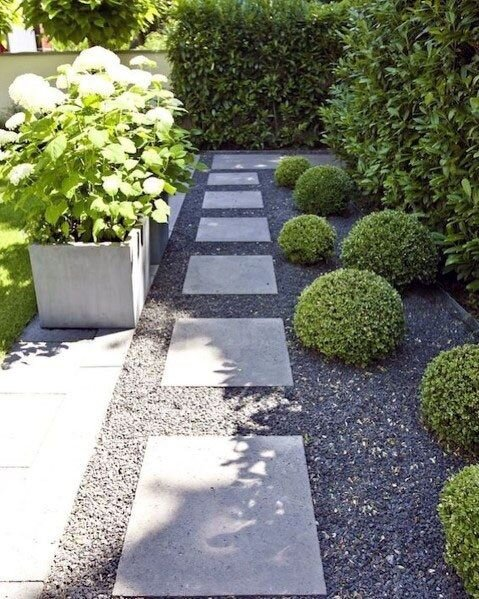 Modern gravel and paver walkway with round shrubs - inspiration for our front side yard makeover.jpg