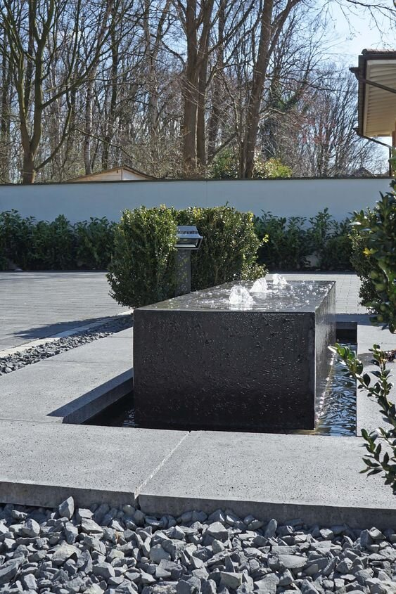 Modern water feature fountain with rocks and concrete - inspiration for our front side yard makeover.jpg