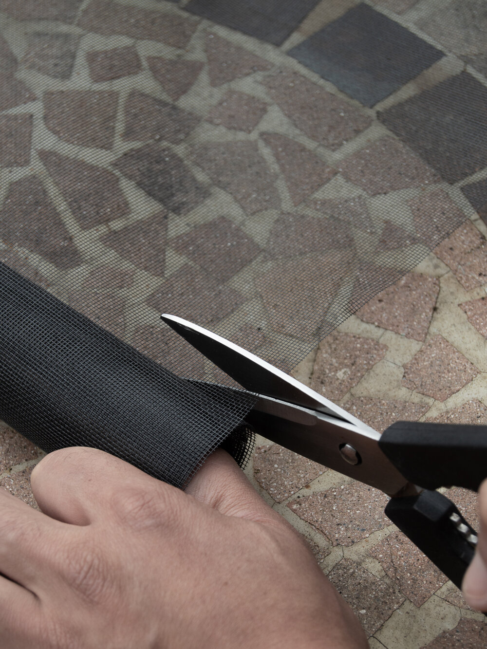 Cutting screen mesh for a DIY Modern table fountain with bubbling feature.jpg
