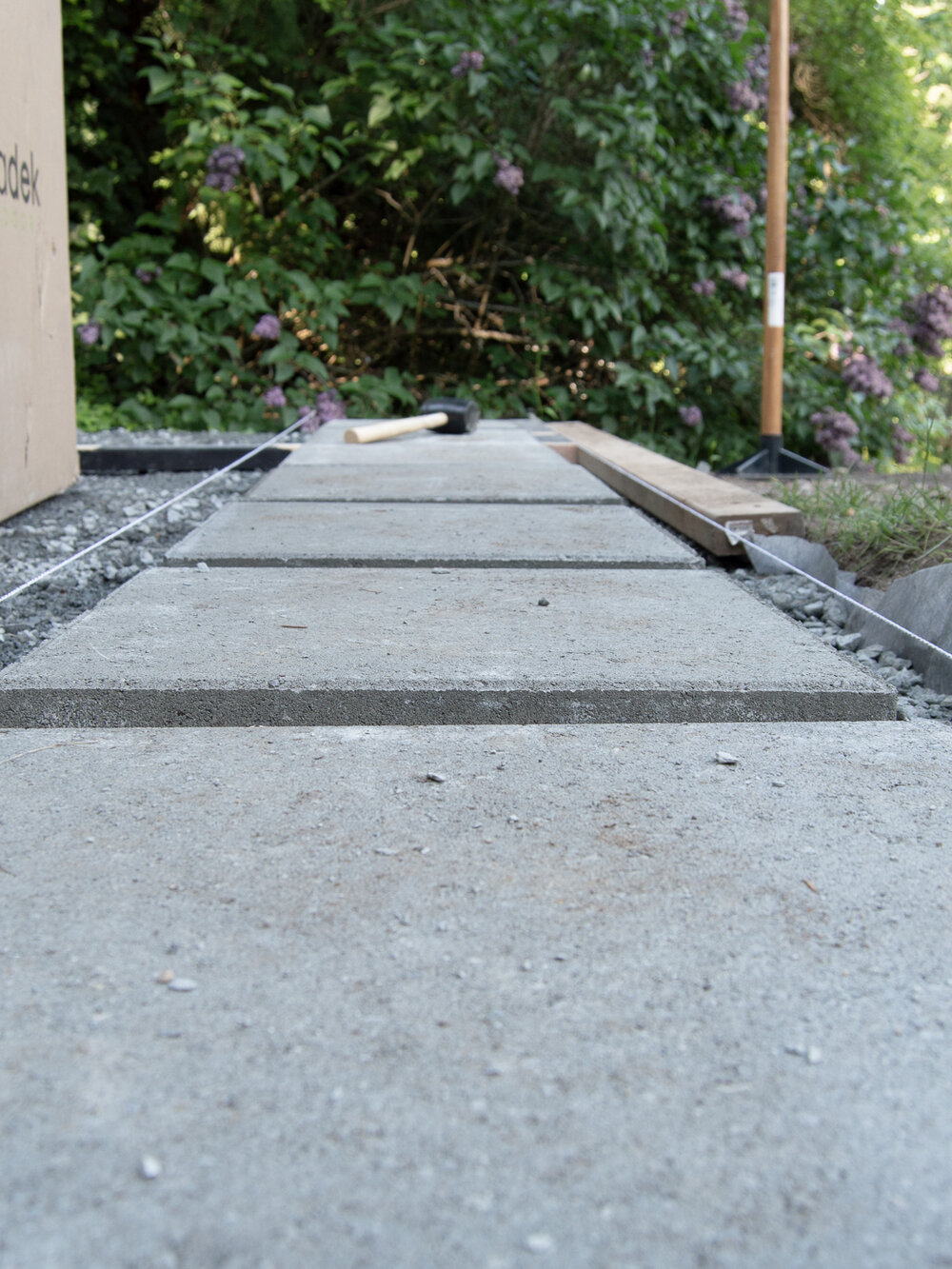 DIY - A modern paver and gravel pathway and patio - Landscaping outdoor oasis by the savvy heart.jpg