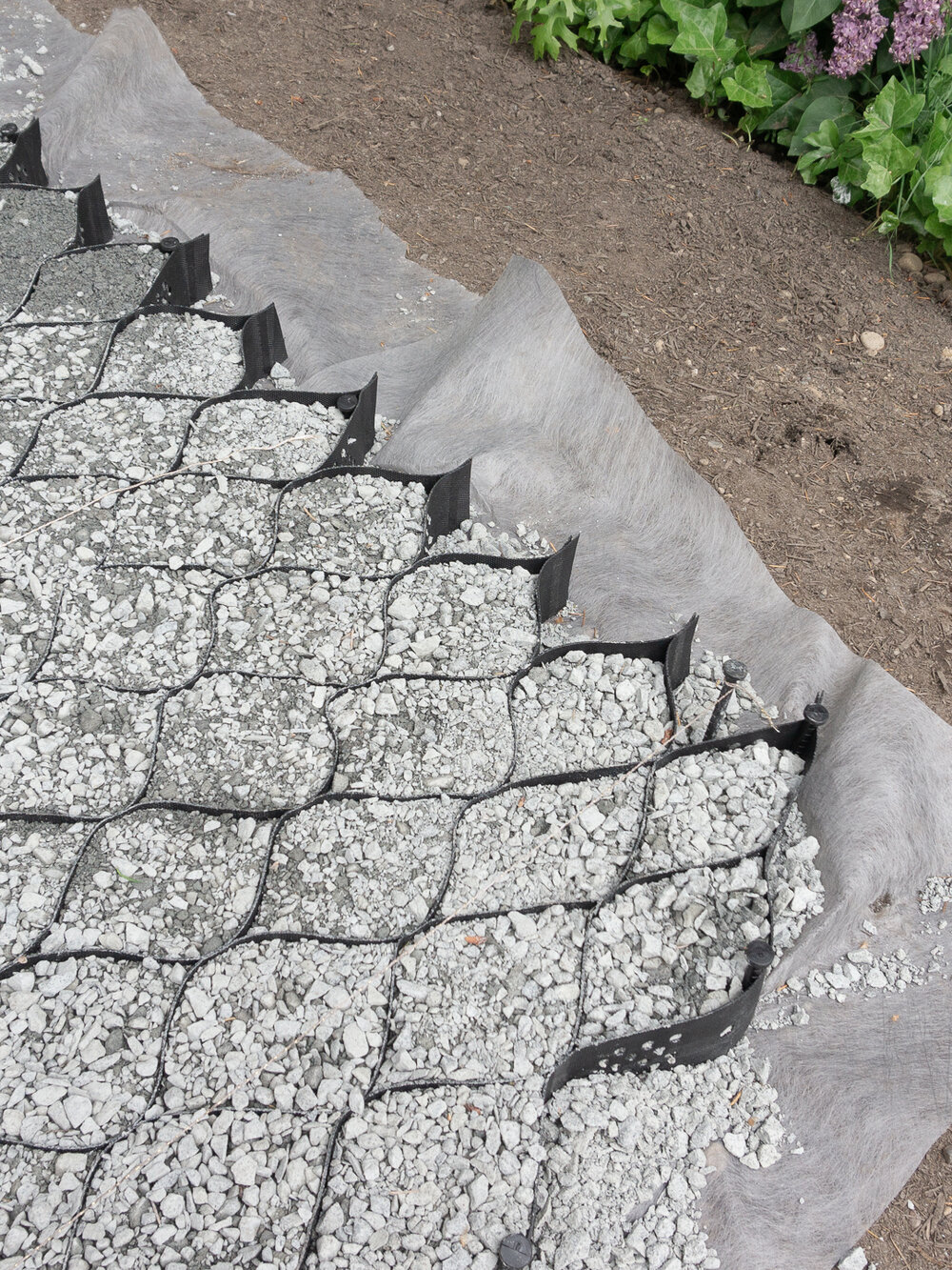 Geocell ground stabilizer for a gravel and paver pathway and patio by the savvy heart .jpg