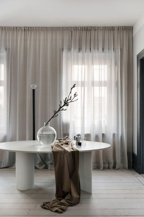 Modern White Dining Room Table with Asymmetrical Legs