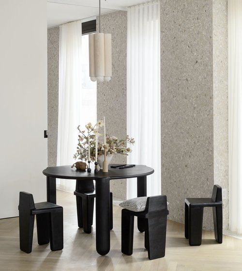 Modern Contemporary Black Round Dining Table in an Eclectic Chic Dining Room Design.jpg