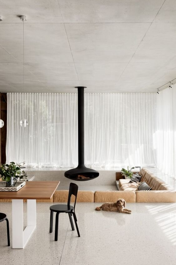 Mid century modern living room with sunken lounge seating area- inspiration for a contemporary home.jpg