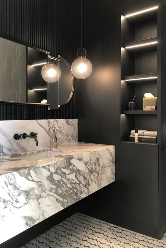 5 Modern and contemporary bathrooms with marble floating vanities - the savvy heart interior design studio.jpg